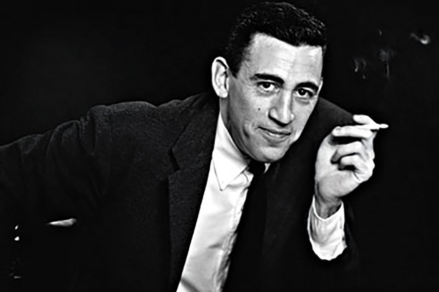 """SAN DIEGO - NOVEMBER 20, 1952: ***EXCLUSIVE - CALL FOR IMAGE*** JD Salinger poses for a portrait as he reads from his classic American novel """"The Catcher in the Rye"""" on November 20, 1952 in the Brooklyn borough of New York City. Salinger died on January 27, 2010.  (Photo by Antony Di Gesu/San Diego Historical Society/Hulton Archive Collection/Getty Images) *** Local Caption *** JD Salinger"""